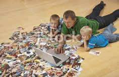 Family watching laptop on the floor Royalty Free Stock Photo With coupon codes and promotional codes.