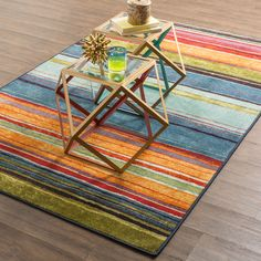 This multicolor area rug is an ideal accessory for any space that requires a vibrant look, including a child's room. The bold stripes are weaved through this 5 x 8 foot nylon rug that has a 0.406 pile height making it soft to walk across.