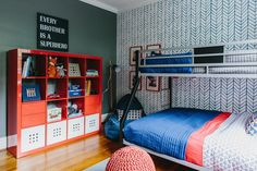 Bold patterns and bright colors create a fun space for brothers to share. A Kallax shelf unit from Ikea offers ample space for storing toys and books, and bunk beds leave room for the boys to play.