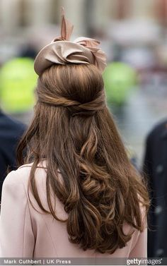 Kate wore a unique half-up hairstyle, in which two pieces of hair, clipped behind her head, helped to hold up a small bouffant behind her hat as she attended the Observance for Commonwealth Day Service at Westminster Abbey on March 9, 2015 in London.