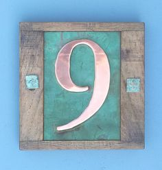 """Eco friendly House number in Copper with oak frame 1 x 3""""/75mm or 4""""/100 mm high numbers in Garamond, unique on the web"""