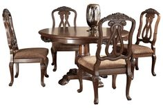 Ashley North Shore Round Dining Room Pedestal Table And Chairs