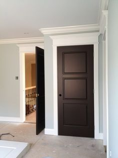 Dark doors, white trim and crown molding over each door. This will be the look in my home. :) Dark doors, white trim and crown molding over each door. This will be the look in my home. Dark Doors, Black Interior Doors, House, Home, Home Remodeling, New Homes, Doors Interior, Stained Doors, Interior Trim