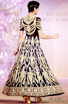 MAJESTY IN MOTION  Taking inspiration from the striking architecture and old textiles of Bali, the 'Dancing Dolls' collection is one of Abu Jani Sandeep Khosla's finest contribution to the art of couture.