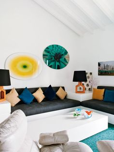 Using a variety of shapes is a great way to create a dynamic living room // Living Rooms