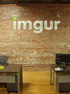 imgur office - fairly common design with exposed brick, wooden floors and modern furniture, but it works