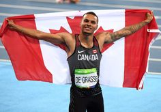 Canada's Andre De Grasse celebrates bronze in the men's 100-metre final during…