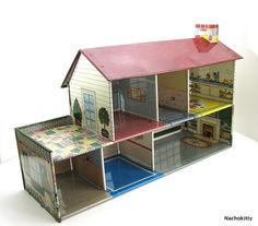 Old Doll House. I had this exact doll house when I was a little girl.  I loved it and played with it for hours. It was metal and had little metal rounded point things that stuck into holes and bent down to hold it together.