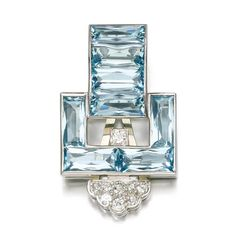 Aquamarine and diamond clip, Cartier, circa 1930. Of buckle design, set with fancy-cut aquamarines and accented with circular-cut diamonds.