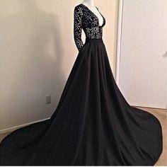 Black low cut evening gown.