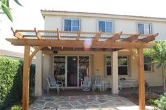 Pergola- clear corrugated roofing panels, I like it, so the birds won't be able to poop on the patio furniture!
