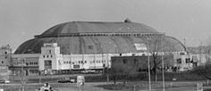 """The St. Louis Arena (also known as The Checkerdome from 1977 to 1983, and popularly referred to as """"The Barn"""") was an indoor arena located in St. Louis, Missouri, that stood from 1929 to 1999. The arena was the site of conventions, concerts, political rallies, horse shows, circuses, boxing matches, Roller Derby competitions and other sporting events like basketball and frozen ice hockey."""