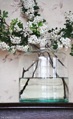 These simple white flowered branches with greenery paired with an simple oversized clear glass container take me right to the shore and big powerful forces of nature, like the ocean, nearby.