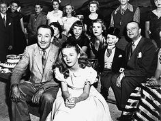 """Walt Disney with Kathryn Beaumont (voice of """"Alice,"""") on set for """"One Hour in Wonderland."""" Behind him are his daughters, Diane and Sharon, sitting next to Edgar Bergen and Charlie McCarthy."""