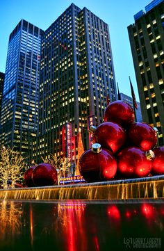 NYC . Christmas - Sixth Avenue holiday decor with Radio City in background
