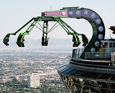 Insanity~Stratospher, Vegas~ Extends 64 feet over the north edge of the tower. Spinning over 40 mph, riders are angled down by 70 degrees so all they see is the street, 900 feet below.