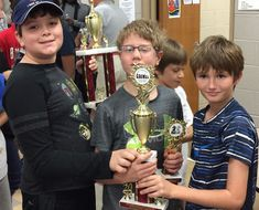 LAMS Chess Club members competed in a chess tournament at Meigs Magnet School. Kyrian placed first in the unrated elementary division (grades 4-6), and the boys also won the first place team trophy in their division!