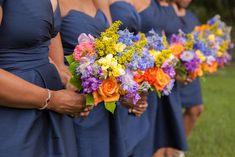 Navy bridesmaids dresses and multi-colored bouquets by Lee James Floral, photo by artphotosoul.com