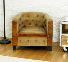 If ever a chair had the wow factor it's this one. Who would have thought that a design well past its sell by date in terms of furnishing trends could become so popular in 2014? The basic tub style has been taken to a whole new level with the clever use of fabrics, colour and design details. £494