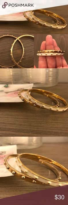 Kate Spade Bangle Set Kate Spade Bangle Set. One gold, one cream bracelet and dust bag included. Please notice wear in photos, these are pre loved. kate spade Jewelry Bracelets