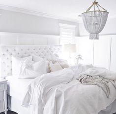 Jillian Harris bedroom. White tufted headboard. White linens.