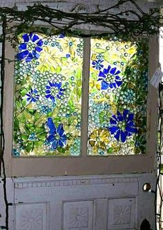 Mosiac window made with broken colored glass and glass dots from the dollar store Pretty, looks easy, too! Mosaic Crafts, Mosaic Projects, Stained Glass Projects, Mosaic Art, Mosaics, Blue Mosaic, Mosaic Tiles, Art Projects, Sea Glass Art