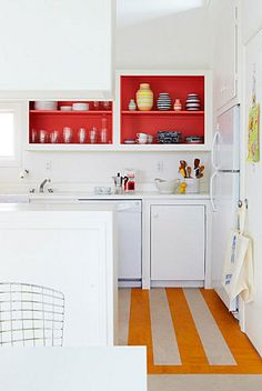 For PT kitchen, bright rug, bright feature wall. White cupboards.