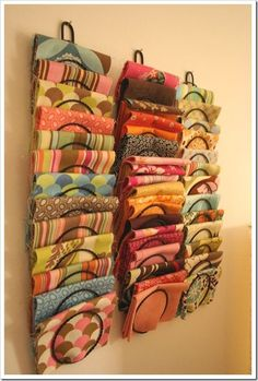 Organize fat quarters on the wall using a letter holder!