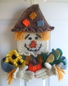 Crochet Pattern for Scarecrow Door Hanging. Pattern can be found at: http://crochetvillage.com//
