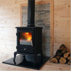 This cast iron log burning stove is perfect for use in a Log Cabin. Wood, Garden Log Cabins, Log Cabin, Outdoor Living, Summer House, New Homes, Log Burning Stoves, Traditional Garden, Open Plan Living