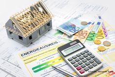 House with money and calculator. Mortgage calculation