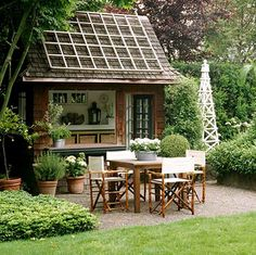 A cute Potting Shed (or you could use it as a guest room); complete with its own little outdoor patio area.