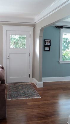 -dining room with Benjamin Moore's Mount Saint Anne (blue grey) - living room: warm gray from Sherwin Williams Amazing Gray - trim. Sherwin Williams Snowbound