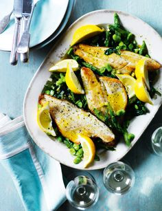 Sea bass with asparagus, broad beans and spinach, a light and fresh Easter recipe.