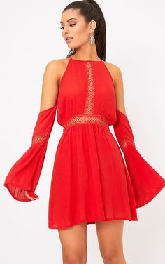 Red Cheesecloth Cold Shoulder Swing DressThis is a must have dress for your holiday wardrob...