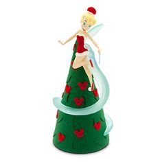 Disney Resort Exclusive - 2014 Lighted Tinker Bell Tree Topper - New. Festival of fantasy Tinker Bell brings a pinch of pixie-dust to the family tree with this retro style topper. Felt cone is crowned by a fully sculptured Tink figurine frosted in glittering fantasy and flocking, plus illuminated wings and flight path. Expressive, fully sculptured figurine Glitter and flocked accents Illuminated transclucent wings and flight path with infused glitter Felt cone with ''hidden Mickey...