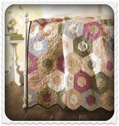 Love this Hexagon #Quilt! @JoAnnStores  I love to LOOK at this, but the one I started many moons ago still in unfinished...