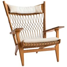 Hans J. Wegner JH-719 Armchair by Johannes Hansen | From a unique collection of antique and modern lounge chairs at https://www.1stdibs.com/furniture/seating/lounge-chairs/