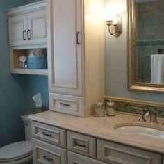 Like this one with the tall storage on the vanity top and cabinetry over the commode