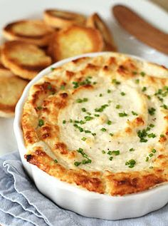 ~Cheesy Onion Souffle~ 1 lg vidalia chopped -3 (8-ounce) pkgs of cream cheese, softened -2 cups grated Parmesan cheese -½ cup mayo -½ tsp cayenne pepper -¼ cup finely chopped chives,  Salt & ground black pepper.Preheat oven 425º F-Combine onion, cream cheese, Parmesan cheese & mayo in food processor. Process until smooth. Add the cayenne & fold in the chives. Salt/pepper to taste.Transfer mixture to a 1-quart baking dish. Bake until browned & puffed, garnish w/ chopped chives.   Serve warm.