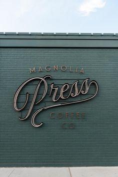 A Look Inside Magnolia Press Wayfinding Signage, Signage Design, Branding Design, Logo Design, Graphic Design, Cafe Signage, Storefront Signage, Entrance Signage, Store Signage