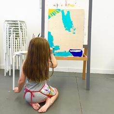 We had a painting day! I love this inexpensive, sturdy IKEA easel. I had toddlers in the studio last week and they were happy scribbling with chalk on the other side, I use it as a sandwich board for events, and of course it's great for painting. Although my 5-year old was quite content sitting, I think it may be time to get this girl something taller! 😆
