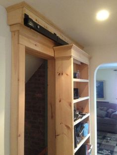 "This shelf is actually a sliding door. This is not your typical ""barn door"" and we love this practical solution."