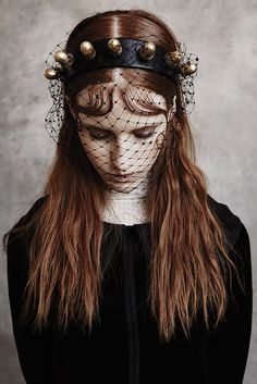 Giorgio Armani's silk velvet top with Veronique Branquinho's cotton lace top. Headpiece by Piers Atkinson. [Photo by Billy Kido]