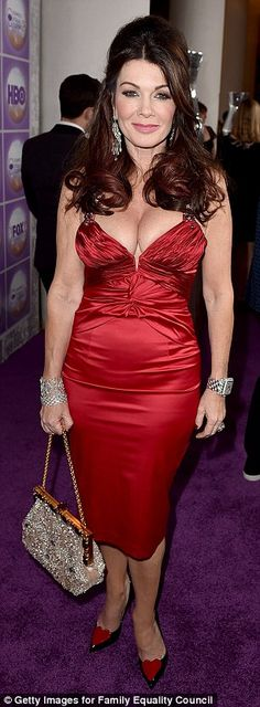 Red hot! Lisa Vanderpump showed off her jaw-dropping cleavage in a low-cut red pencil dres...