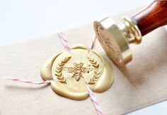 I've recently become kinda obsessed with stationary - not least among them being the old-fashioned way of sealing letters. Is this awesome or what? OP: Bee Wreath Gold Plated Wax Seal Stamp x 1 by BacktoZero on Etsy, Honey Packaging, Soap Packaging, Jewelry Packaging, Buzzy Bee, I Love Bees, Ideias Diy, Bee Art, Wax Seal Stamp, Bee Happy