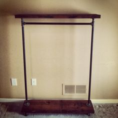 Industrial Garment Rack with Top Shelf 42 by TylerKingstonWoodCo.  Could totally DIY this in style.  You could even paint or cover the pipe with tape, fabric, etc.