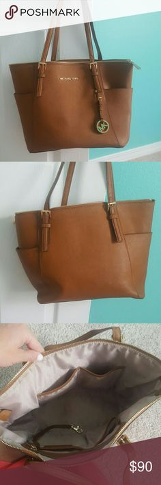 Michael kors tote Perfect sized tote- some wear on the top of the strap but still great condition Michael Kors Bags Totes