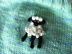Detailed instructions on how to embroider a small lamb or such in the corner of your knitted item