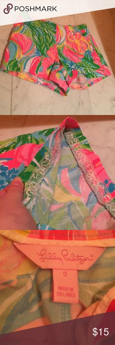 Lilly Pulitzer bright shorts These shorts are brand new only worn a few times. They are very vibrant. There is sparkly color lace lining the inside of the shorts. They zip and button on the side. Lilly Pulitzer Shorts